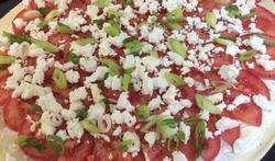 Tomatentaart met feta en lente-ui