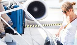 Hoe stap je goed voorbereid in een vliegtuig?